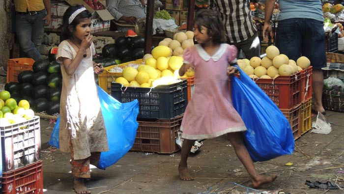 Child Protection - two street girls collecting paper
