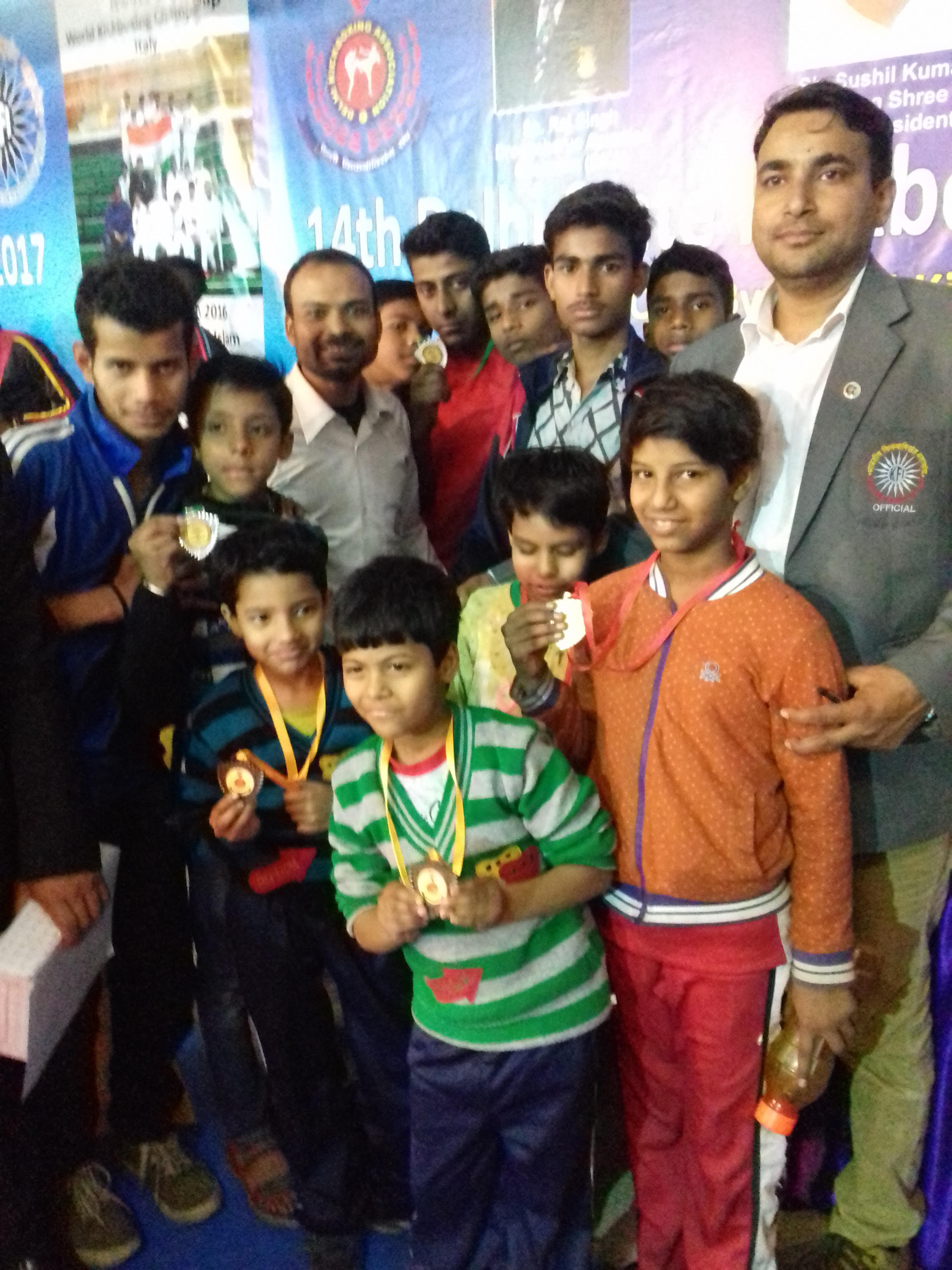 Anand won silver medal in Delhi state kick boxing championship